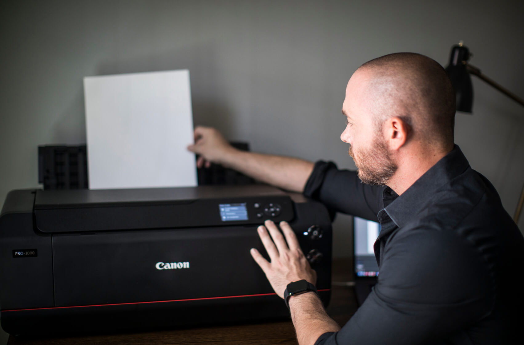 Michael Anthony loading paper into the printer
