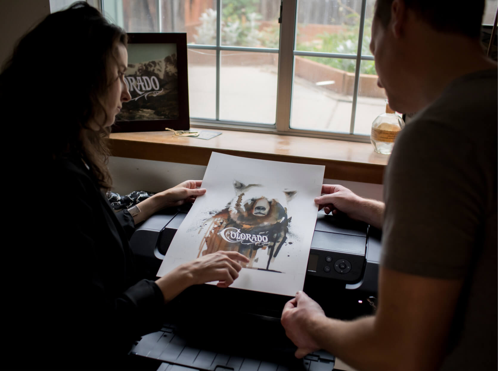 Cristy & Kevin from Lucky Onion inspecting a finished print